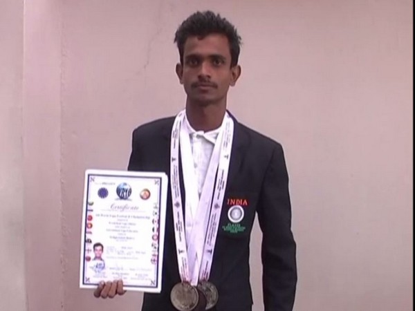 Toran Yadav with his medals and certificate.