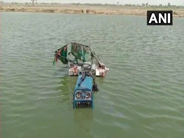 Tractor that fell into a pond in Bharatpur on Sunday. (ANI)