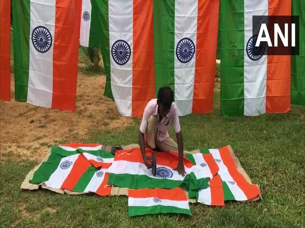 A visual of flagmaker printing the Indian flag in Agartala. (Photo/ANI)