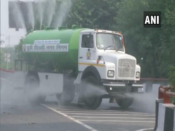 EDMC sprinkles water on roads in Lakshmi Nagar [Photo/ANI]