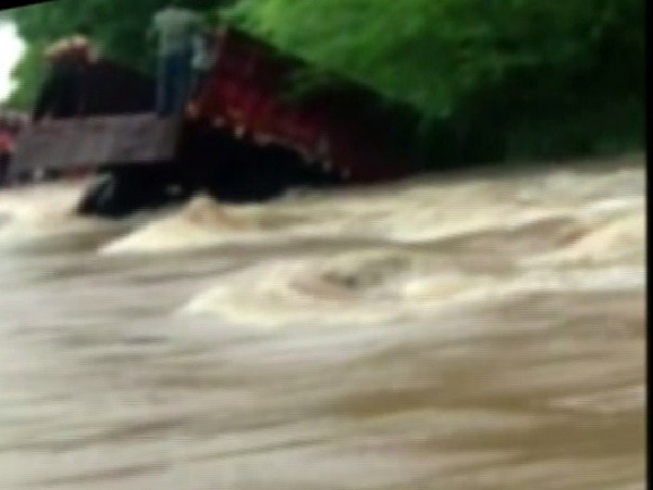 Truck carrying girl students skids off due to overflowing stream in Dungarpur, Rajasthan on Saturday.