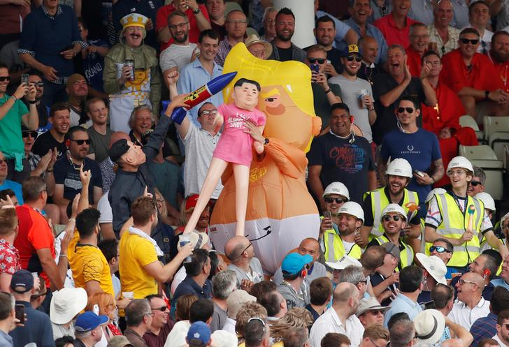 A man dressed as the Trump baby blimp holding a Kim Jong-un dummy at the first Ashes Test on Aug 3 in Edgbaston (Photo/Reuters)