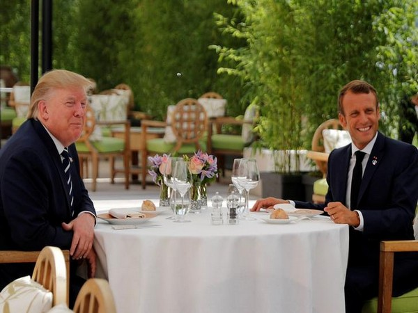 US President Donald Trump (L) with French President Emmanuel Macron (R) at a lunch meeting in Biarritz on Saturday ahead of the G7 Summit (Photo/Reuters)