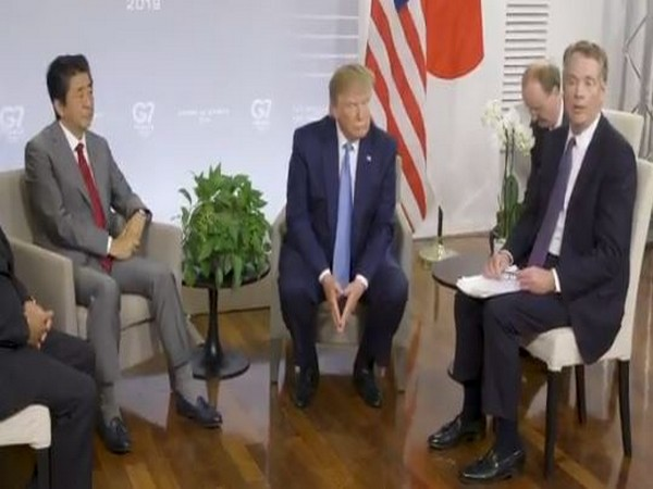 Japanese PM Shinzo Abe (L) US President Donald Trump (C) and the US Trade Representative Robert Lighthizer (R) at the presser in Biarritz, France on Sunday (Photo/The White House)