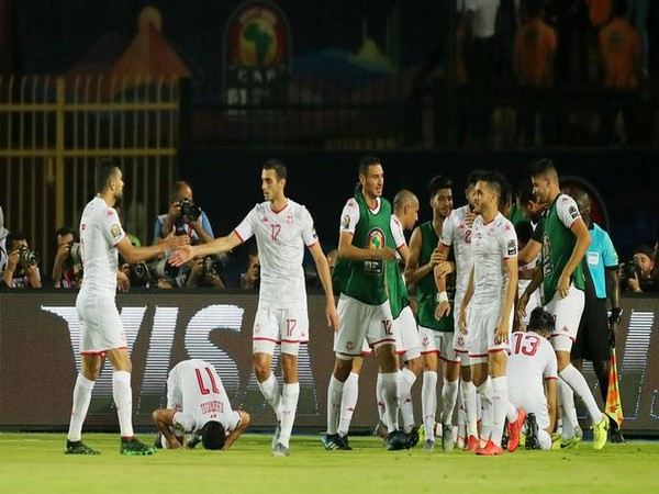 Tunisia players celebrating after scoring against Madagascar in the quarter-final match.