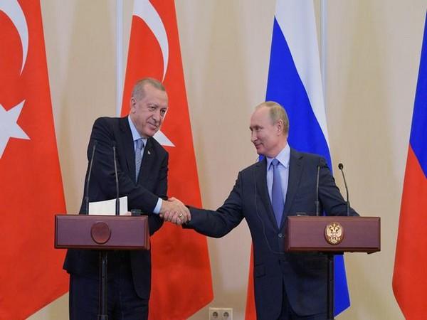 Russian President Vladimir Putin with Turkish President Recep Tayyip Erdogan addressing a press conference after their talks in Sochi