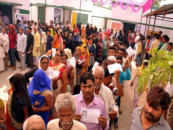 People standing in a queue to cast their vote in Sultanpur, Uttar Pradesh, during 6th phase of polling on Sunday. Photo/ANI