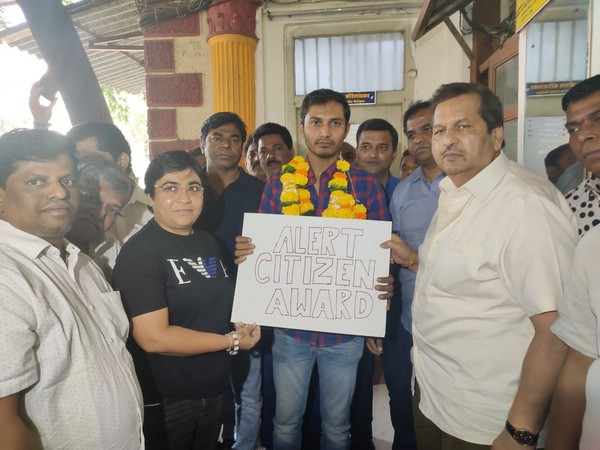 Uber driver Rohit Singh (holding placard) with Mangal Prabhat Lodha (right)