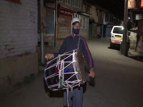 Traditional drum beater in Srinagar, Nazir Ahmad (Photo/ANI)