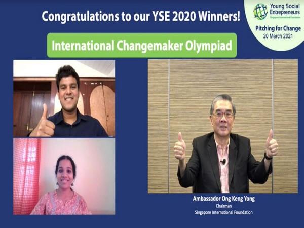 Rahul Adhikari and P Sai Sindhu from International Changemaker Olympiad receiving the winning announcement from the Chairman of Singapore International Foundation