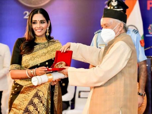 Dr Leena S. being felicitated by Shri Bhagat Singh Koshiyari