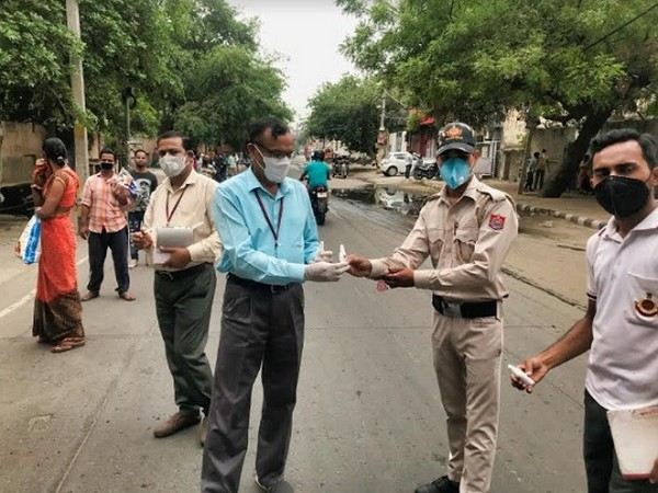 Pharma Synth company representative distributing sanitizers to police