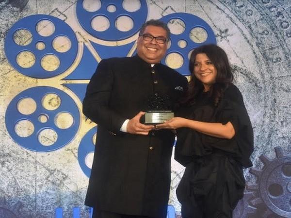 Mayor of Calgary, Canada Naheed Nenshi presenting award to Bollywood Director Zoya Akhter at IIFTC Awards 2020 Ceremony held in Mumbai
