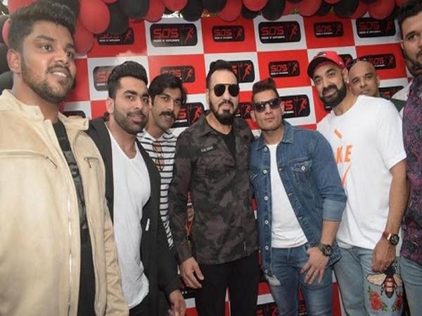 Junaid Kaliwala with Shera and friends at SOS store launch