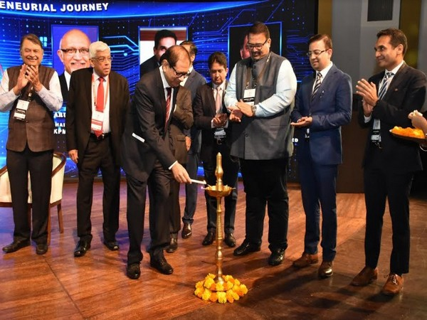 Atul Nishar lighting the lamp during the inauguration of TiEcon Mumbai 2020 as Deepak Parekh and the TiE Mumbai board look on.