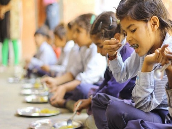 Girl Child enjoying her mid-day meal