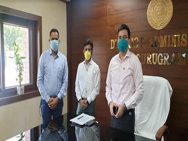 Ajay Ambewadikar and Vikas Kikan of CNH with A K Khatri, DC Gurugram