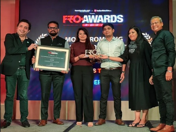 Elan Group Team receiving the award