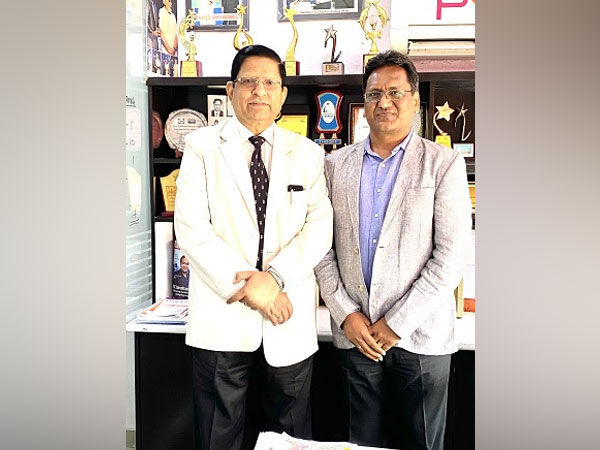 Ashok Mittal (Right) is welcoming R.K. Dubey (left) in Prest Loans Office