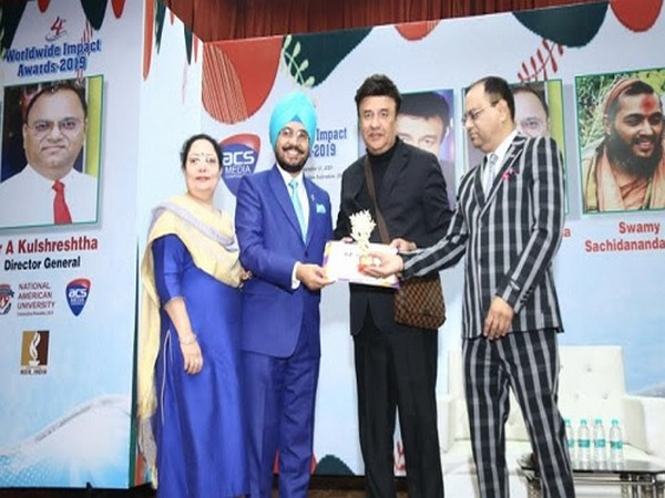 From Right to LeAnu Malik - Music Director and Singer presenting Explanatory Journalism Award to Dr HS Paul - Delhi Bureau Chief, and Sharan Kaur - Chief Manager (Delhi Office), Daily Excelsior