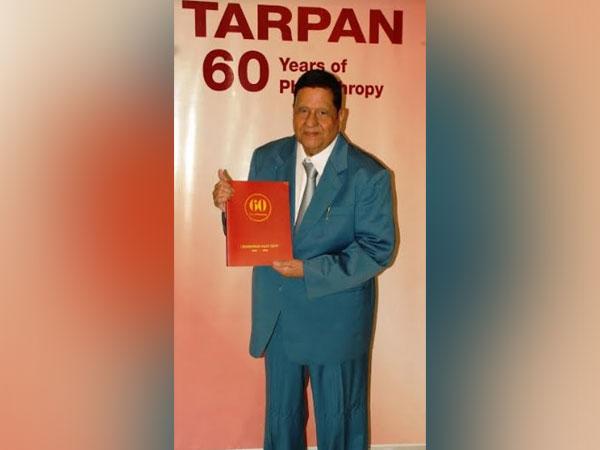 Mahavirprasad Saraf releasing 'TARPAN 60' - citing various activities of the Trust