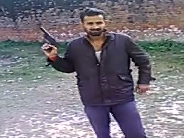 One of the inmates in Unnao jail brandishing a non-licensed weapon. Photo/ANI