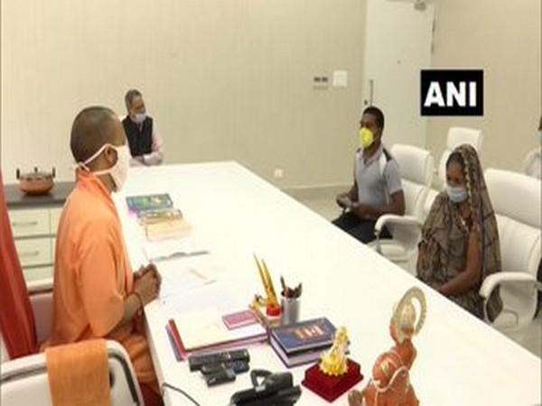Family members of sub-inspector Nebulal meeting UP CM Yogi Adityanath on Sunday. Photo/ANI.