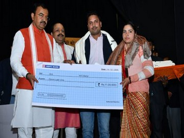 Visuals of Keshav Prasad Maurya giving cheque to wife of a CRPF personnel, who was killed in Pulwama attack last year. Photo: Twitter@kpmaurya1