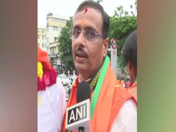 Deputy Chief Minister Dr Dinesh Sharma during a road show in Lucknow on Monday. Photo/ANI