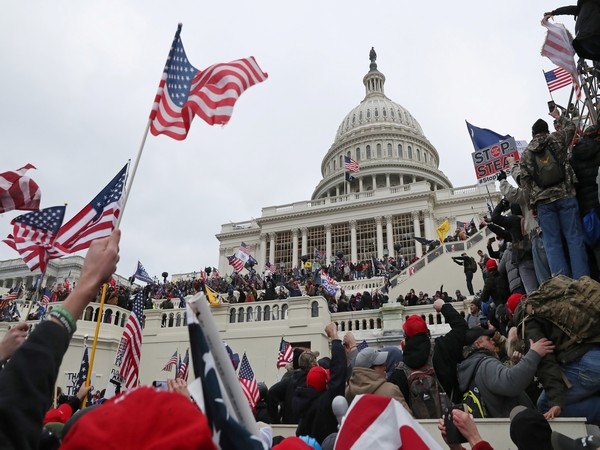 Group of Donald Trump's loyalists had breached the US Capitol, clashing with police, damaging property, seizing the inauguration stage and occupying the rotunda. (Photo credit: Reuters)