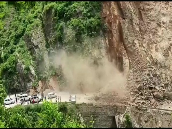 Badrinath National Highway 07 was blocked after section of the hill near fell in Chamoli district. (Photo/ANI)