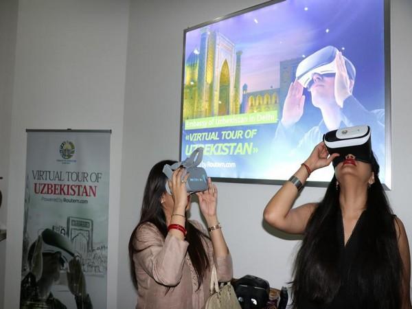 Visitors at the 'Virtual Tours to Uzbekistan' corner at the Embassy of Uzbekistan in New Delhi