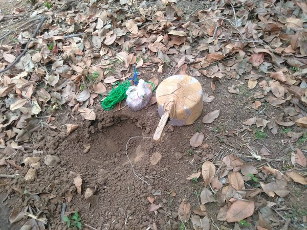 Picture of the unearthed pressure cooker IED. (ANI)