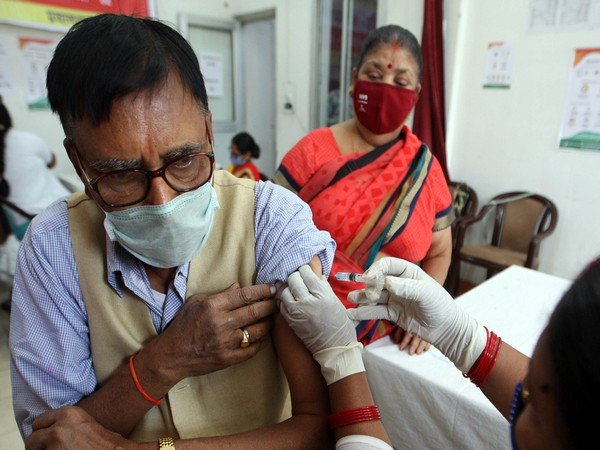 A beneficiary receives a dose of covishield covid-19 vaccine at an auditorium. (Photo/ANI)