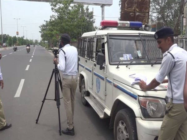 Vadodara traffic police monitoring over speeding by vehicles on roads by using speed guns.