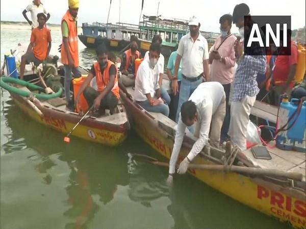 Team of Namami Gange' project conducting cleaning drive of river Ganga in Varanasi. (Photo/ANI)