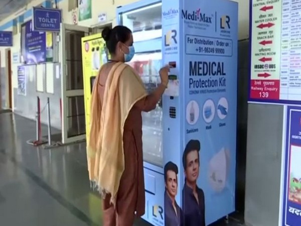 A customer using the vending machine to purchase a sanitiser  at the Chandigarh Railway Station (Photo/ANI)