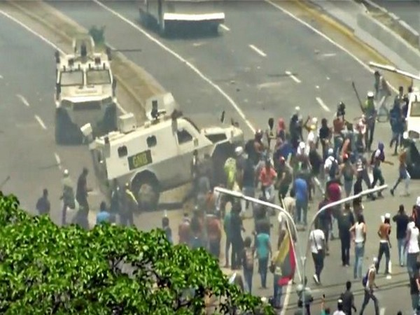 A Venezuelan National Guard (GNB) vehicle ploughs into opposition demonstrators in Caracas, Venezuela on April 30 (Photo/ Reuters)