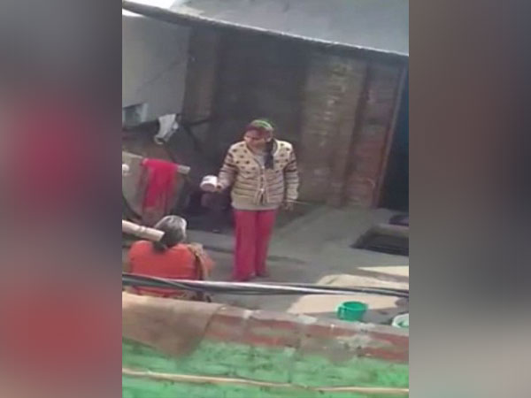 A grab of the video where the woman from Etah is shouring on her mother in-law [Photo/ANI]