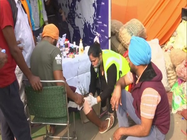 Medical staff dressing injuries of a farmer at the Singhu border. (Photo/ANI)