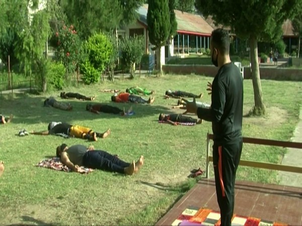 Quarantined people practice Yoga in Doda, Jammu and Kashmir.