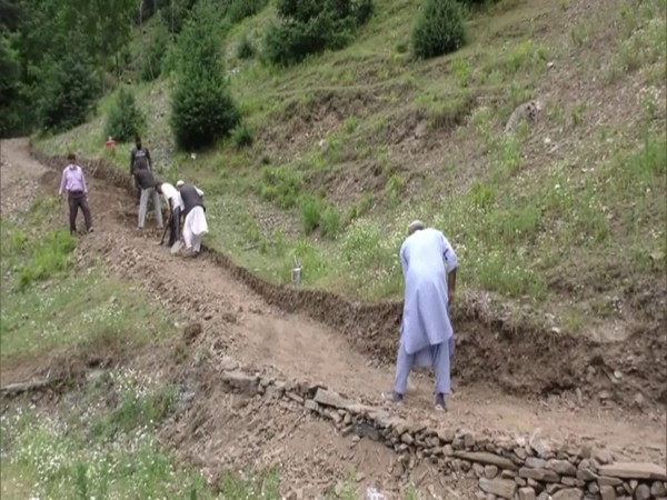 Local workers involved in construction work in Uri and Boniyar blocks in Jammu and Kashmir. (Photo/ANI)