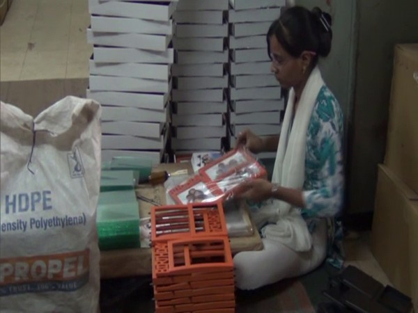 A production worker in Morbi, Gujarat packaging a photo frame. (Photo/ANI)