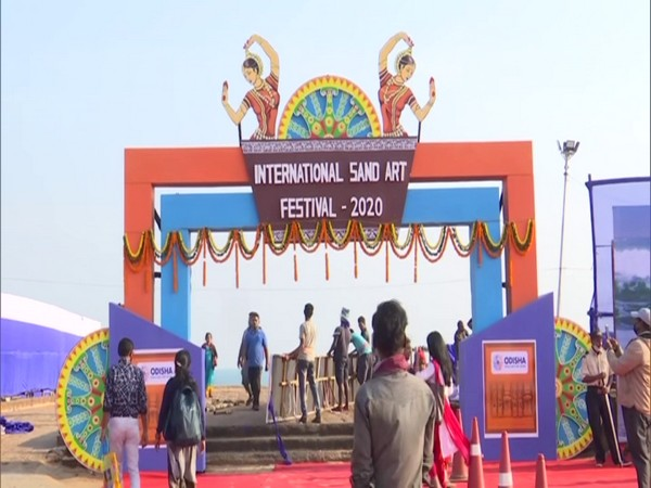Visitors at the entrance of the International Sand Art Festival at Puri's Chandrabhaga Beach. (Photo/ANI)