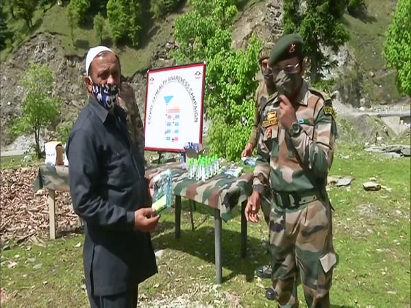 Indian Army distributing ration to the Gujjar and Bakarawal community. (Photo/ANI)