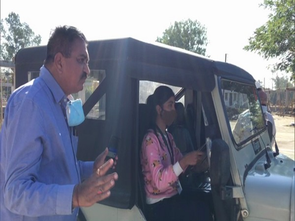 An officer guiding a women participant at Driving Training Institute in Indore. (Photo/ANI)