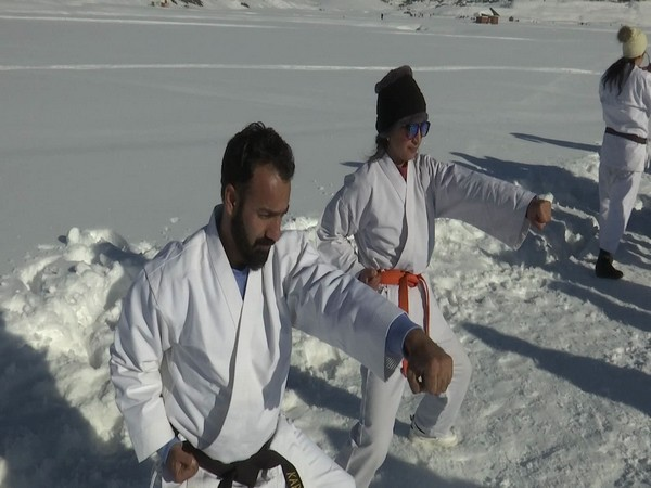 Karate players practicing in J-K's  Gulmarg during winter camp. (Photo/ANI)