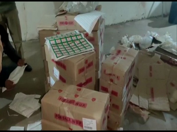 A large quantity of liquor seized from the site. (Photo/ANI)