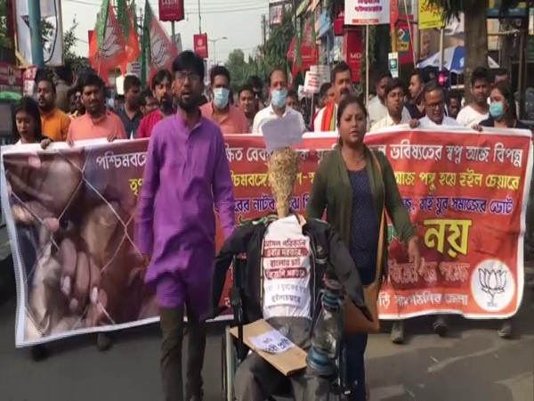 BJP supporters at the 'wheelchair rally' in Siliguri. (Photo/ANI)