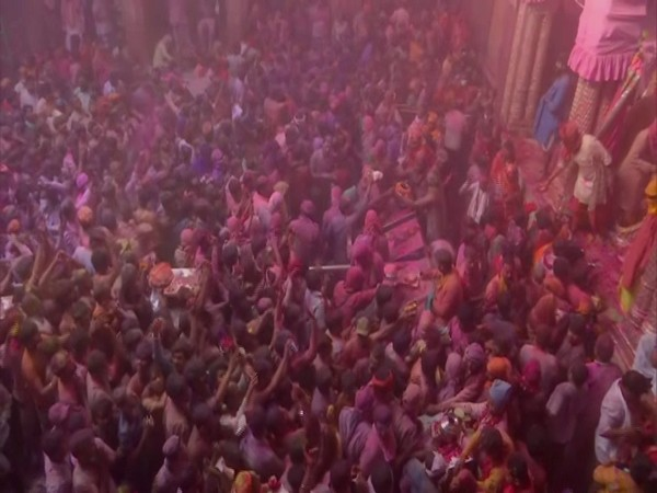 Priests at the temple were seen playfully throwing colours on devotees at Banke Bihari Temple in Vrindavan. (Photo/ANI)